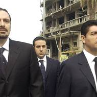 Bahaa Hariri, right, and Saadeddine Hariri, sons of slain Lebanese former Prime Minister Rafik Hariri, visit on Saturday, Feb. 19, 2005 the bombing site in central Beirut where their father and 16 other people were killed in a massive bombing that targeted the former premier's motorcade on Monday.(AP photo / str)