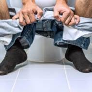 Man on toilet.